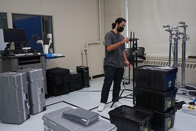 UML senior Lucas Bermudez checks out new equipment in the digital media studio
