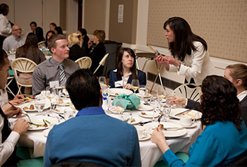 Etiquette expert Jodi Smith guides students through a four-course meal at a recent Dine and Dress for success event.