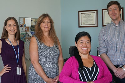 UMass Lowell Disability Services staff, from left to right: Lauren Tornatore, Jody Goldstein, Janelle Diaz and Brandon Drake