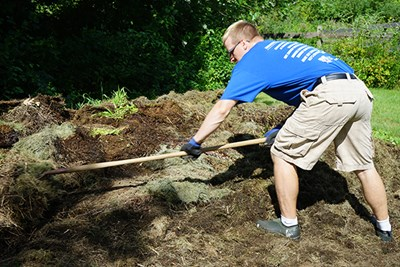 UMass Lowell student Tyler Lagasse turns over his compost pile