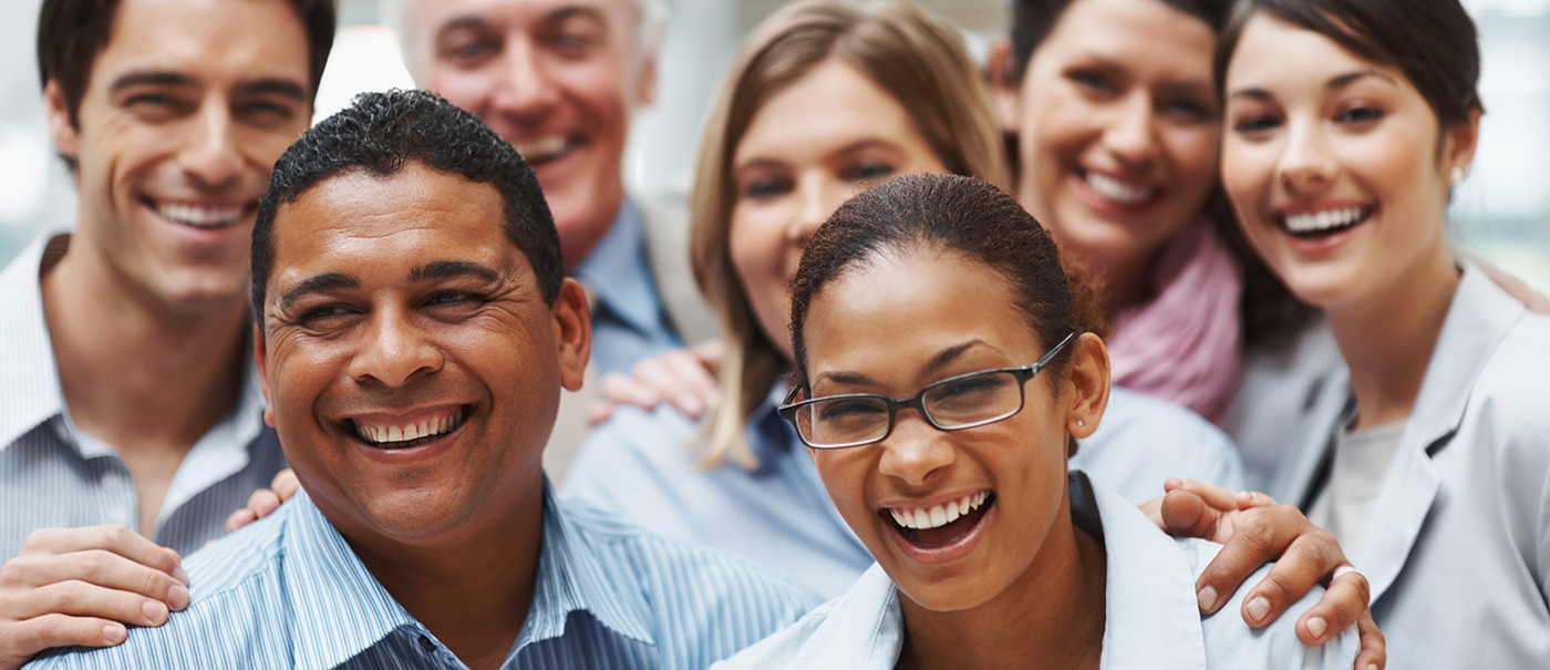 A stock image of a diverse group of people smiling at the camera.