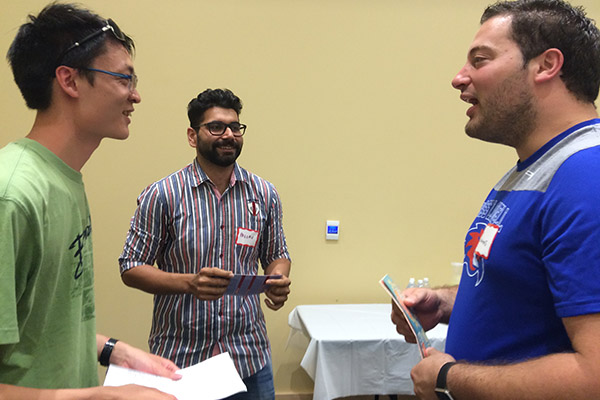 Isaac Ka Shing Chan, Pallav Ratra and Ioannis Smanis chat at a meet and greet held by the Office of Multicultural Affairs.