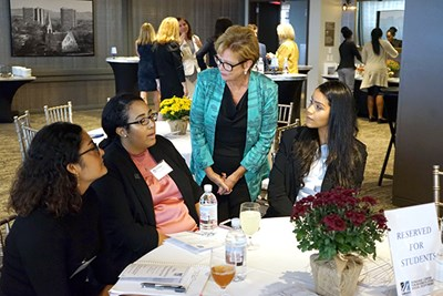 Chancellor Jacquie Moloney greets students at the UMass Club