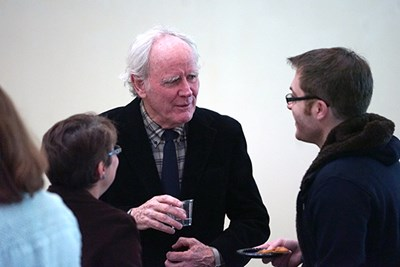 Author James Carroll speaks with a student