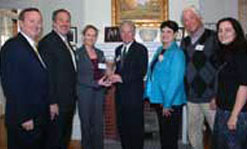 Shown at Allen House during the delegation's visit are, from left, Prof. Frank Talty, Prof. Stephen McCarthy, Mayor Cora Harvey, Chancellor Marty Meehan, Prof. Ann Marie Hurley, Jim O'Brien of the Center for Irish Partnerships Advisory Board, and Victoria Drakoulakos, associate director of the Center for Irish Partnerships.