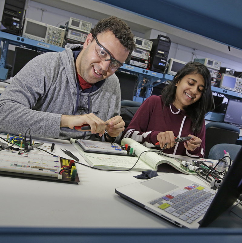 Two Electrical Engineering students work together on a project in the lab