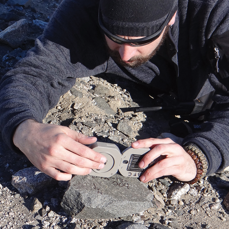 Man working with rocks in Antarctica