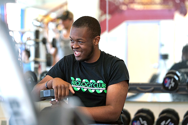 Ralph Saint Louis smiles while working out at the CRC