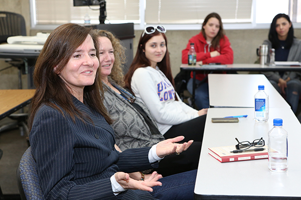 Author E.J. Levy, left, chats with Assoc. Prof. Maureen Stanton's creative nonfiction class during her recent visit as part of the Writers on Campus Series.