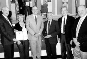 Those honored by EPA include, from left, Project Director Paul Morse; Marketing and Outreach Coordinator Therese O'Donnell; New England Regional Administrator Curt Spalding; UMass Lowell Professor Dr. Kenneth Geiser; principal Investigator of consortium, UMass Lowell professor Craig Slatin; and Training Manager David Coffey.