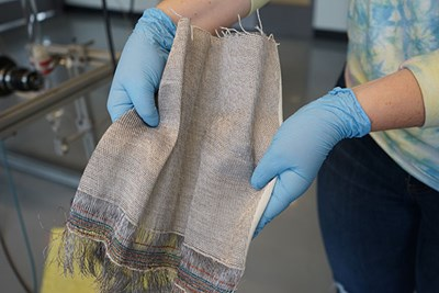Closeup of gloved hands holding fabric