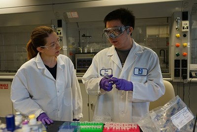 Amy Peterson and student in lab