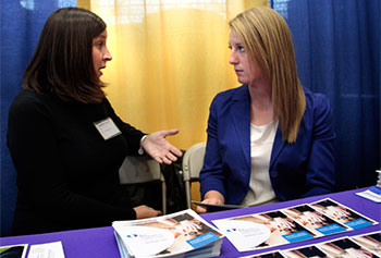 Brianna Martin of Methuen, right, who is studying psychology, talks with Stephanie Cormier of the Key Program.