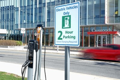 An electric vehicle charging station at University Crossing