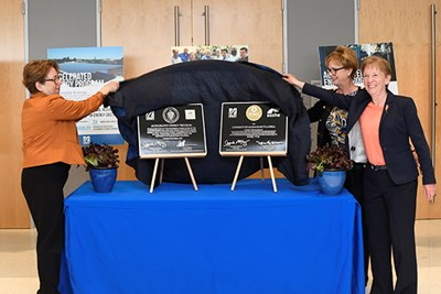 Jacquie Moloney, Joanne Yestramski and Carol Gladstone unveil APE and STARS plaques
