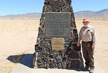 Prof. Nelson Eby poses next to the stone obelisk marking ground zero, the exact spot near Alamogordo, N.M., where the first atomic device was tested 68 years ago, on July 16, 1945.