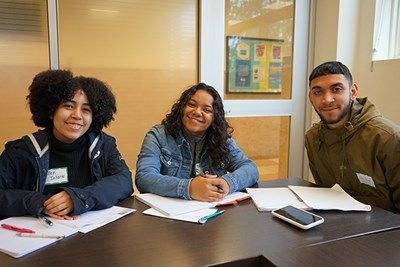 Lawrence High School students Ellen Infante, Yanelyse Lopez and Oscar Burgos attended a teaching methods class at UMass Lowell