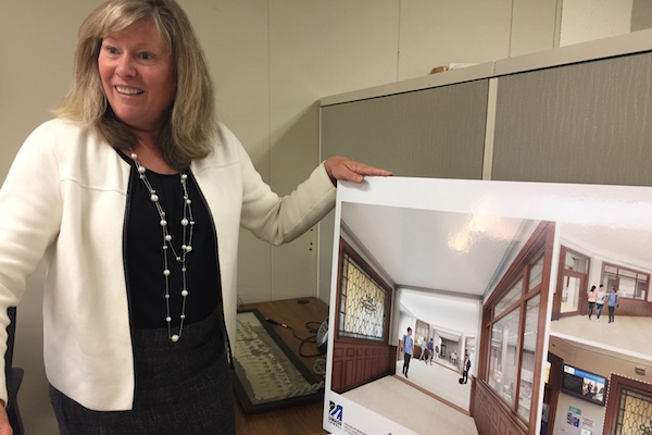 The new Dean of the College of Education Eleanor Abrams shows architect drawings of Coburn Hall renovations.