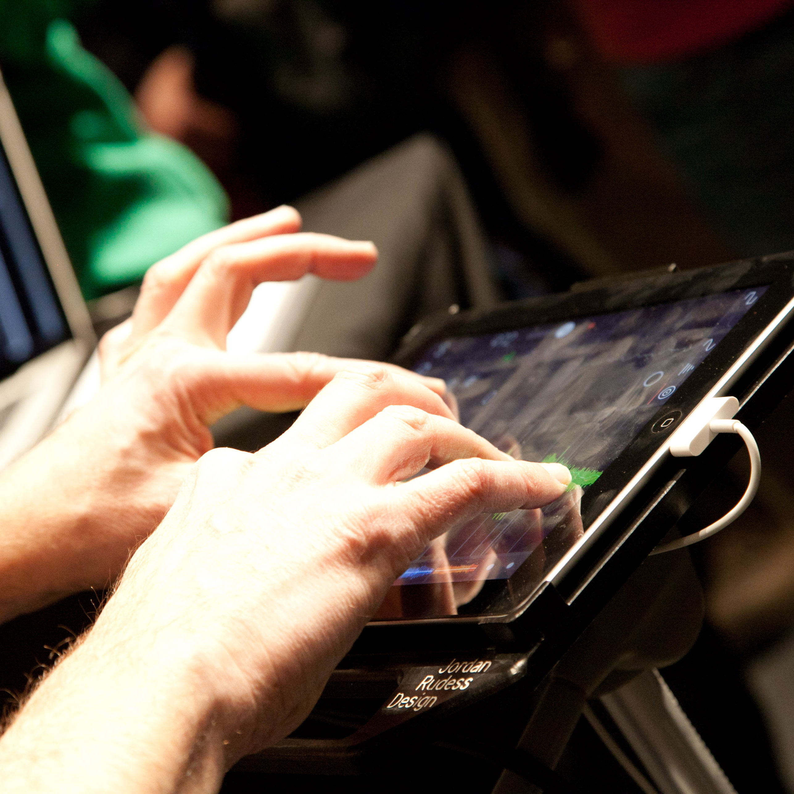 Image of hands composing music on an iPad, music department