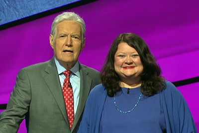 Librarian Ellen Keane poses with Jeopardy host Alex Trebek