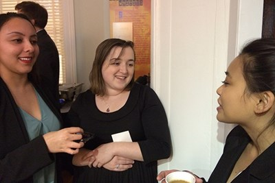 Emily Yunes (center) talks with two other Emerging Scholars at the midwinter presentation.