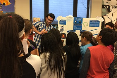 Lorenzo Chiodi demonstrates extrusion to a group of rapt fifth-graders.