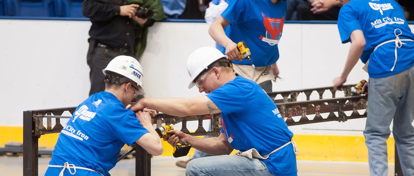UMass Lowell students work on their team's Steel Bridge during the competition at the 2014 New England ASCE Student Conference.