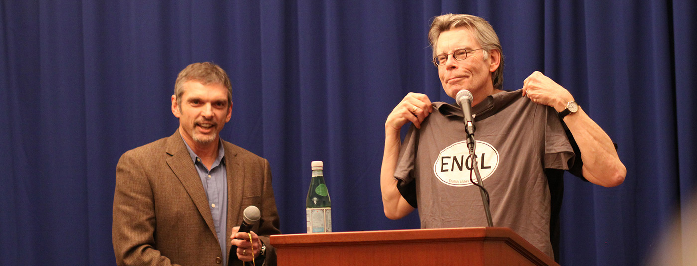 English Chair, Tony Szczesiul  presents author, Stephen King  with a t-shirt after speaking to UMass Lowell English students.