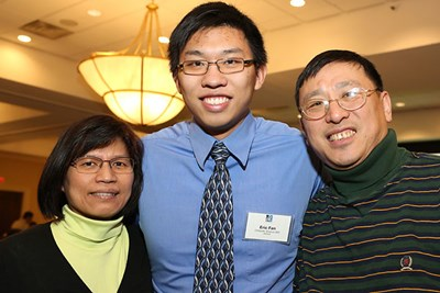 Student Eric Fan with his parents.