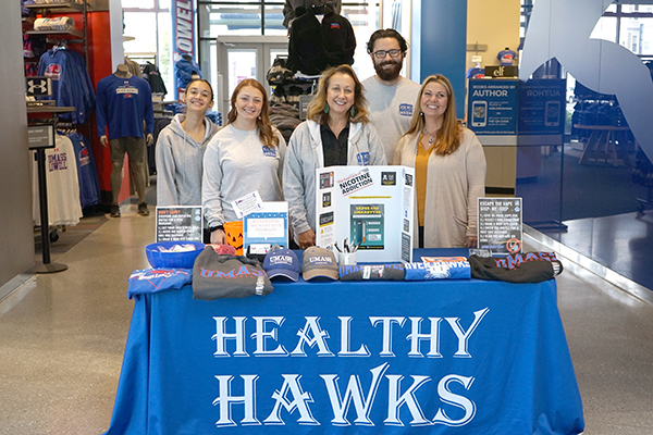 Healthy H.A.W.K.S. members, from left, Sara Feinstein, Morgan Francese, Advisor Tracy Moore, Coordinator Jeremy Laporte and River Hawk Shop Director Ginger Delfino man the vape pen exchange table at University Crossing.