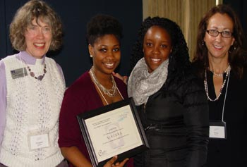 Imogene Stulken, left, of the Protestant Campus Ministry, presents a Splash! Award to members of the student organization SISTERS – Elena Lafortune, president and senior psychology major, and Thrisha Heaven, also a senior psychology major. Tracy Moore of Student Health Services, right,  advises the group.