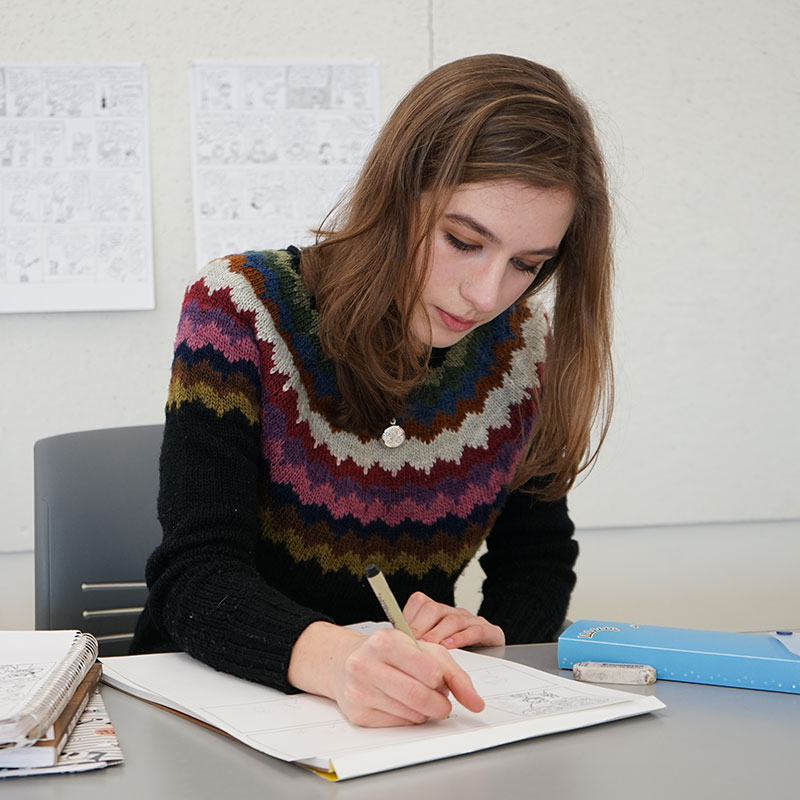 Young woman writing in notebook