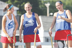UMass Lowell field hockey teammates, from left, sophomore Kayla MacDonald of Chelmsford, senior Abby Auld of Waltham and junior Chelsea Gillies of Chelmsford don't appear to be feeling any pressure to repeat as nationals champions.  Lowell Sun Photo by Julia Malakie