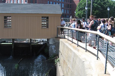 First-year Honors College students check out the Swamp Locks Gatehouse in Lowell