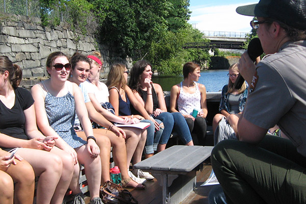 Students in the First-Year Seminar in Honors take a boat tour on the Pawtucket Canal with a Lowell National Historical Park ranger.