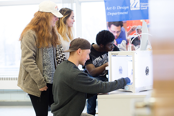 Students use a 3-D scanner in the new Fab Lab