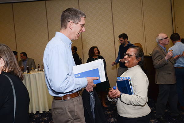 Asst. Teaching Profs. Walter Thomas (mechanical engineering) and Chandrika Narayan (physics) chat during a break at the annual Faculty Symposium at the UMass Lowell Inn & Conference Center.