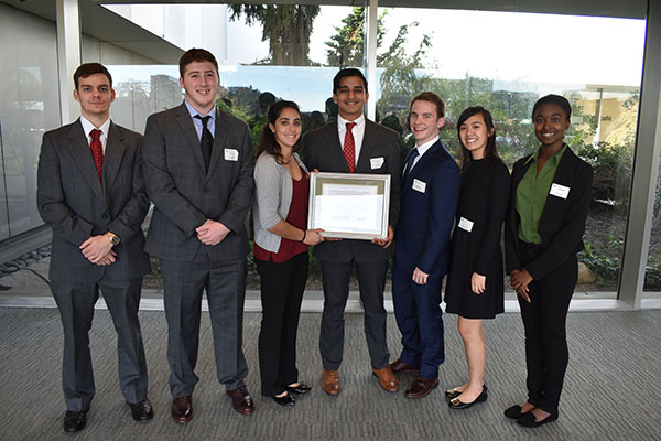 Members of the Federal Reserve Challenge team, from left: Sam Klett, Matthew Cunningham, Alessandra Greco, Raffah Siddiqui, Daniel Falcone, Olivia Cheung and Danyel Pollock.