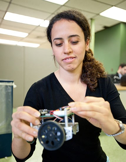 Female-ECE-Student-holding-robot-build-550-opt.jpg