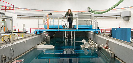 Female-student-looking-down-into-pool-Nuclear-Reactor-550-opt.jpg