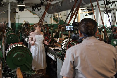 Lowell National Historical Park interpretation ranger Allison Horrocks enacts a mill girl on a virtual field trip