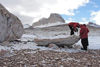 Asst. Prof. Kate Swanger�s team collects samples from a sandstone boulder in the Olympus Range in Antarctica.