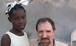 Prof. Robert Giles in Haiti with Kerline, the first Haitian student that Giles and his family started to support in 2003.