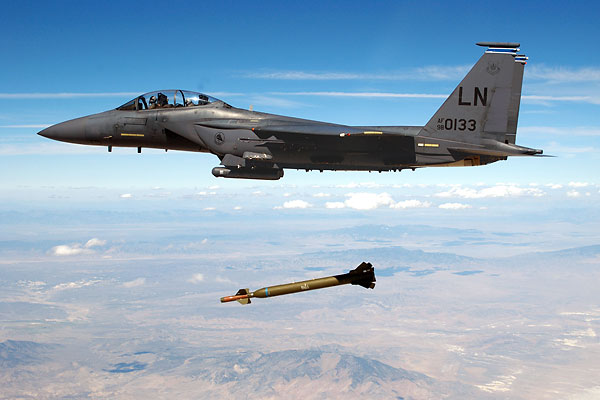 "An F-15E Strike Eagle fighter jet releases a GBU-28 ""bunker buster,"" a 4,700-pound laser-guided bomb. Conventional smart bombs and guided missiles were first used during the 1991 Gulf War and, more recently, in Iraq, Afghanistan and Syria."