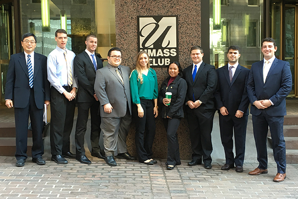 Lecturer Chan-Wung Kim, left, and his Student Managed Fund class visit the UMass Club in Boston, where they were recognized for their investment performance.