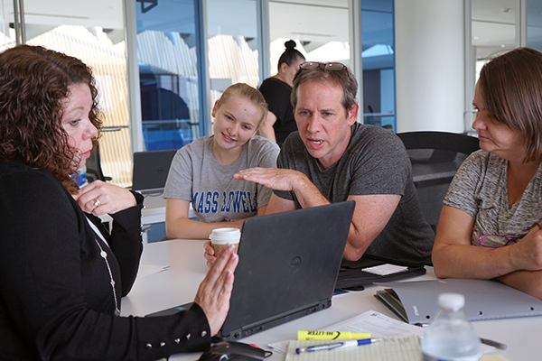 Assoc. Director of Student Financial Services Monica Vachon, left, goes over loan options with incoming student Nicole McClung and her parents, Jeff and Terri, at University Crossing.