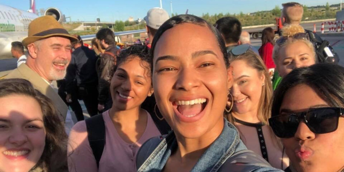Franchesca Arias takes a selfie in Spain during her study abroad program with a group of students and Assoc. Teaching Prof. Thomas Piñeros-Shields