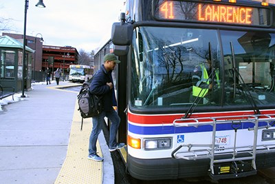 Ramses Jimenez boards an MVRTA bus in Lowell