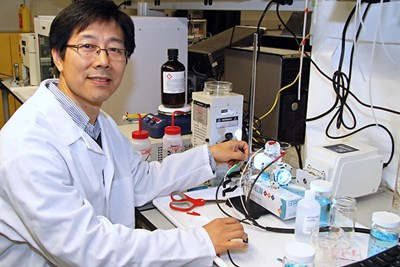Assoc. Prof. Fuqiang Liu working in the lab