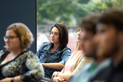 students listen to the panel discussion